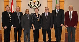 members of the town council pose in council chambers