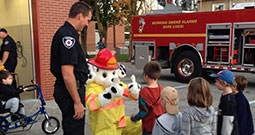 fireman and mascot talk to children