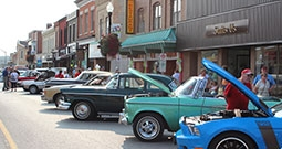 vintage cars parked on street for car show